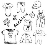 Clothes for baby boy set hand drawn sketch,  on white background Stock Photos
