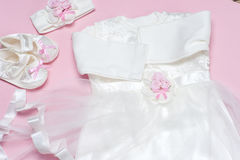 Clothes for baby girl on a pink background. Copy space Stock Photography