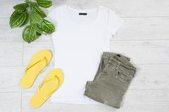 Clothes background top view, accessories summer concept t-shirt mock up on wooden floor, fashion shirt empty for logo, empty