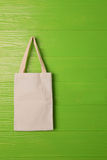 Clothes bag on green background Stock Photography