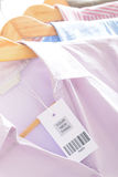 Clothes with a barcode label Royalty Free Stock Photo