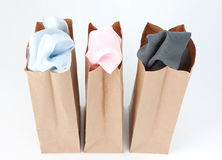 Clothes In Brown Paper Bags Royalty Free Stock Photography