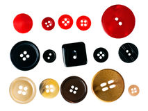 Clothes buttons - red black and brown, beige isolated on white Royalty Free Stock Photo