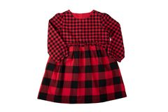 Clothes for children. A beautiful red and black checkered girl d stock images