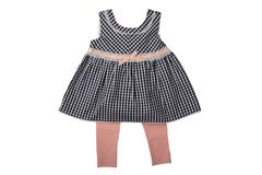 Clothes for children, a black and white checkered baby girl dres stock images