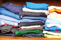 Clothes for children in a wardrobe Royalty Free Stock Image