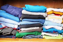 Clothes for children in a wardrobe Stock Photography