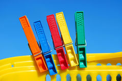 Clothes clips. On a blue background Royalty Free Stock Image