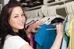 Clothes in closet stock images