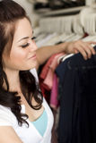 Clothes in closet. Woman looking at clothes in a closet stock photography