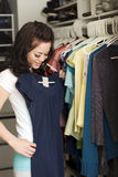 Clothes in closet Stock Photography