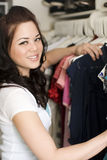 Clothes in closet Stock Photos
