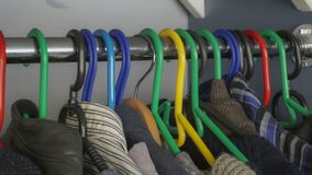Clothes in the closet on hangers. Easy to work with files royalty free stock photo