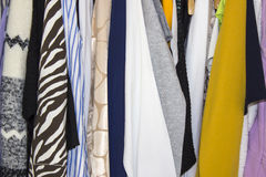 Clothes in a closet on hangers Royalty Free Stock Photos