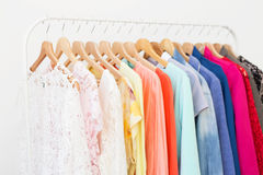 Clothes in the closet hanging on hangers. Clothes in the closet on rack stock photography