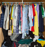 Clothes in the closet. Many clothes in the closet stock photos