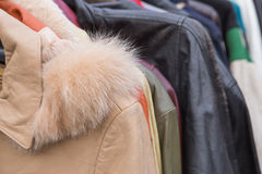 Clothes. Closeup of some used leather clothes hanging on a rack in a flea market stock photos