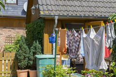 Clothes on the cloth line. Drying in the garden stock photo