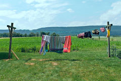 Clothes on a clothesline. Stock Images