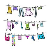 Clothes on the clothesline. Sketch for your design Royalty Free Stock Images