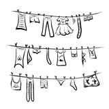 Clothes on the clothesline. Sketch for your design Stock Photo