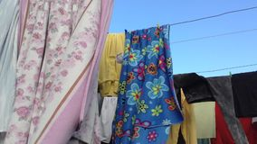 Clothes on Clothesline Waving in Wind stock video footage