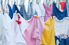 Clothes on clotheslines Stock Photos