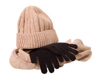 Clothes for a cold season: woolen cap, scarf and gloves. Cap and scarf of beige color, glove black. The object is isolated on a white background Stock Photography