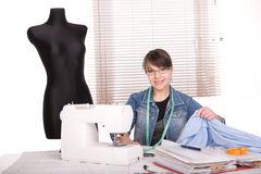 Clothes designer. Young adult fashion designer at work Royalty Free Stock Photography