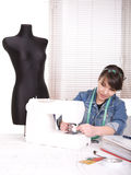 Clothes designer. Young adult fashion designer at work stock image