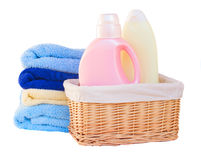Clothes with detergent in basket Stock Photo