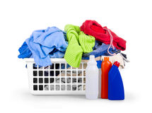 Clothes with detergent and in  plastic basket dropped Royalty Free Stock Photos
