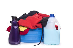 Clothes with detergent and washing powder in plastic basket Stock Image