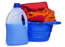 Clothes with detergent and washing powder in plastic basket Stock Photos