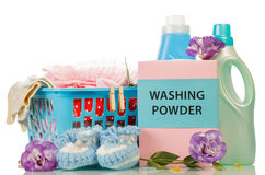 Clothes with detergent and washing powder Royalty Free Stock Photo