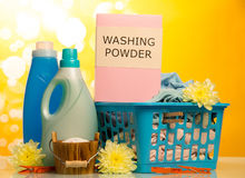 Clothes with detergent and washing powder Royalty Free Stock Photos