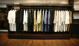 Clothes on display in designer shop stock photography