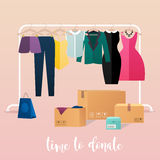 Clothes donation. Girl makes clothes donations. Royalty Free Stock Photo