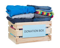 Clothes donations box. Isolated on white background Stock Images