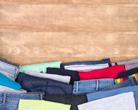 Clothes donations on wooden table Royalty Free Stock Photo