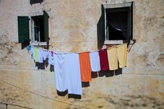 Clothes are dried between windows, Split, Croatia Royalty Free Stock Photos