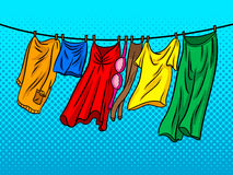 Clothes dries on a rope comic book style vector. Clothes dries on a rope comic book pop art retro style vector illustratoin Stock Image