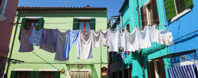 Clothes drying in back yard in Burano. Royalty Free Stock Photo