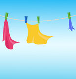 Clothes drying on clothesline Stock Image