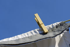 Clothes drying on the clothesline under the blue sky Royalty Free Stock Photos