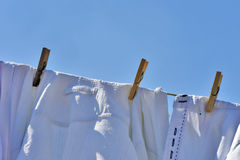 Clothes drying on the clothesline under the blue sky Royalty Free Stock Image