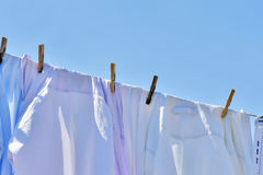 Clothes drying on the clothesline under the blue sky Royalty Free Stock Images