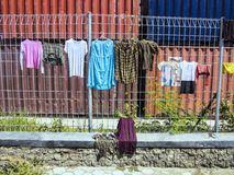 Clothes drying on the fence, Labuan Bayo, Indonesia Stock Photos