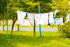 Clothes drying in fresh air on clothes lines stock images