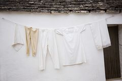 Clothes drying outside a trulli house Royalty Free Stock Photo